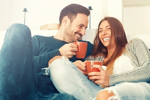 Man and woman relaxing with coffee mugs