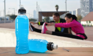 people exercising with sports drink in picture